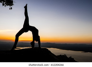 Silhouette Yoga on the sunset