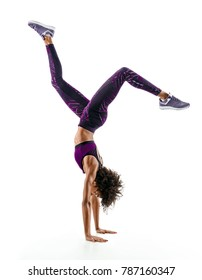 Silhouette of young african girl practicing handstand exercise isolated on white background. Strength and motivation