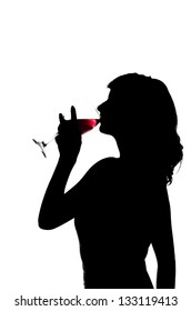 silhouette of Young beautiful woman drinks wine from wine glass, close up.