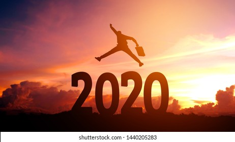 Silhouette young Business man happy to 2020 new year success concept.