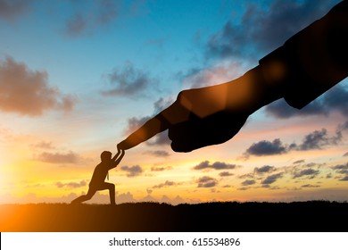Silhouette young businessman take all his energy and production processes to fight the big capitalist over blurred sky.potential and motivate employee growth concept SME and Small Business Management