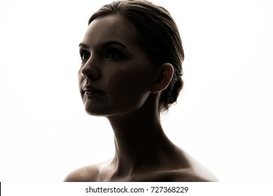 Silhouette of young caucasian woman.
