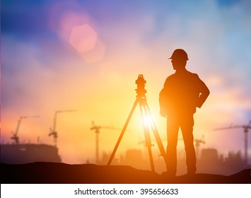silhouette young engineer working construction standards in line with global environment around the site over Blurred  worker on  site