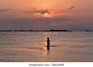 Silhouette of young girl, Glyfada Beach, Greece