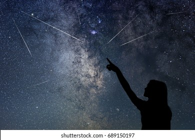 Silhouette of young girl watching Meteor Shower.