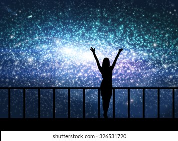 Silhouette of young happy woman stands on the bridge in cosmos