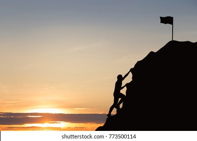 Silhouette of  young man climbing on rock, mountain at sunset background. Business, Success, leadership, achievement and education concept.