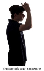 Silhouette of a young man dressing glasses virtual reality on white isolated background