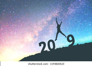 Silhouette young man Happy for 2019 new year background on  the Milky Way galaxy