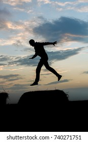 Silhouette of a young man in a jump