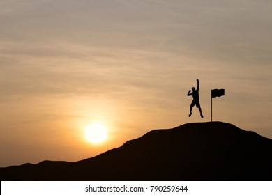 Silhouette of young man are jumping to celebrate success on top of hill, sky and sun light background. Business, successful, leadership, achievement, teamwork and goal concept.