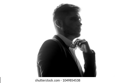 Silhouette of young man portrait with hand on studio isolated white background. Close up.