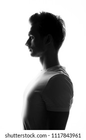 Silhouette of young man posing on white background