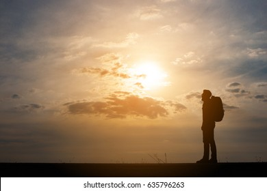 Silhouette of young man traveler.