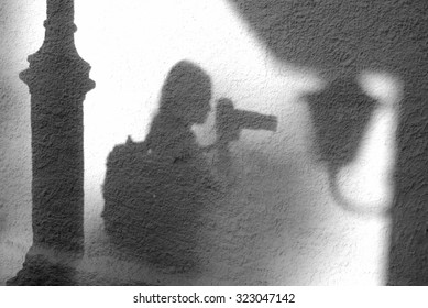 Silhouette of young photographer, girl
