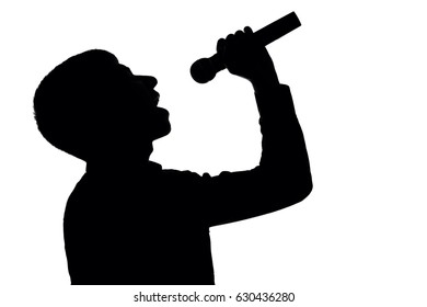 Silhouette of a young pop singer singing emotionally into a microphone in a suit on an isolated white background