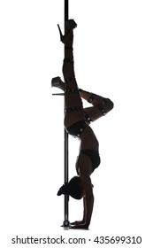 Silhouette of young sexy pole dance woman dancing on white background