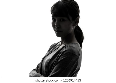 Silhouette of a young woman.