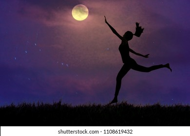 Silhouette, a young woman clutching the moon in open grassland, concept pursues dreams.