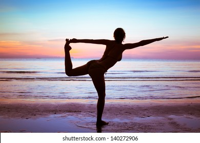 silhouette of young woman doing gym and stretch exercises on the beach