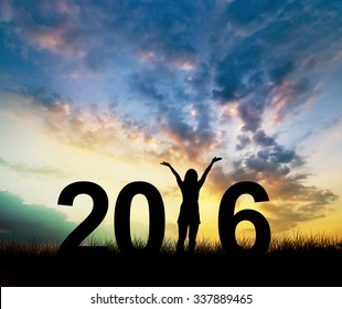 Silhouette young woman Enjoying on the hill and 2016 years while celebrating new year