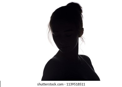 silhouette of a young woman with hairdo, beautiful girl on a white isolated background, concept beauty and fashion