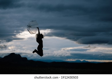 silhouette of a young woman jumping