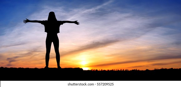 Silhouette young woman jumping on the sea and 2017 years while celebrating new EAP, 2017, happy girl. silhouette of girl at sunset, jumping on the background of sunset