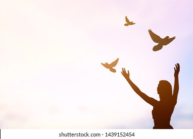 silhouette young women were praying