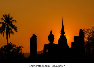 Silhouetteat of Buddha and pagada on sunset time at  Sukhothai History park . History park is  famous landmark in Sukhothai province,Thailand.Thailand tourism concept,Asia traveling concept.