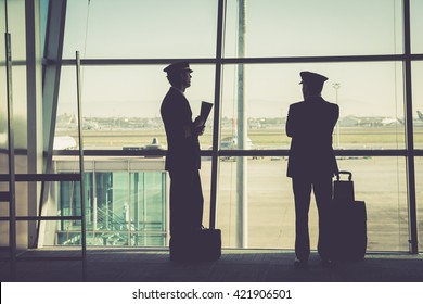 silhouetted airline member crew