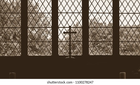 Silhouetted Altar Cross in Old Church, Sepia Tone Horizontal Photography, Shallow Depth of Field
