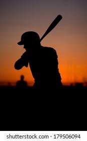 Silhouetted Baseball Batter at Sunset