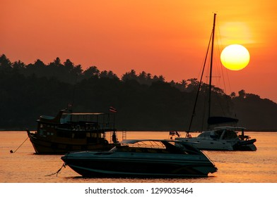 Silhouetted boats at sunrise on Ao Ton Sai, Phi Phi Don Island, Krabi Province, Thailand. Koh Phi Phi Don is part of a marine national park.
