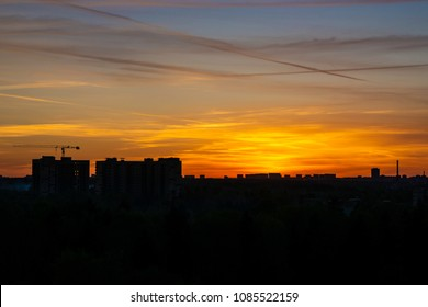 silhouetted city on sunset background