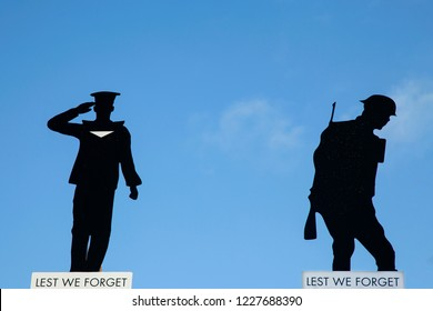 Silhouetted cut outs of service men in the war. Remembrance day 2018
