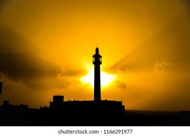 Silhouetted minaret in beautiful sunset from Abha, Saudi arabia