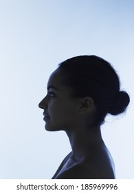 Silhouetted profile of young woman