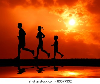 silhouetted runner family running together at sunset