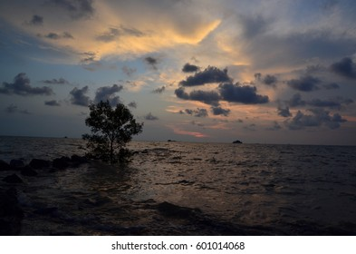 Silhouetted scenery during sunset at Malaysia's beach located in state of Selangor.
