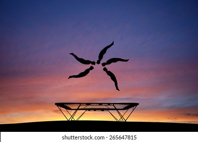 silhouetted trampoline gymnast