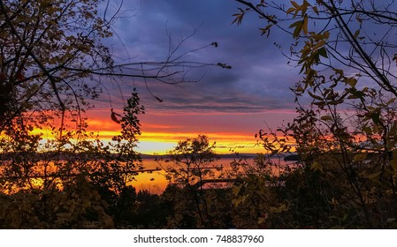 Silhouetted view of a sunset at Lake Champlain in Burlington, vermont during Autumn