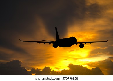 Silhouettes airplane on sunlight background