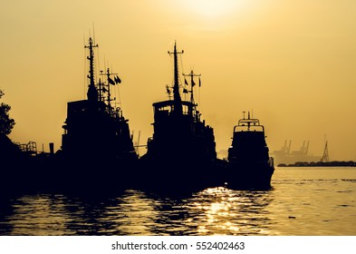 Silhouettes of big boats in the Chao Phraya River, Bangkok Thailand