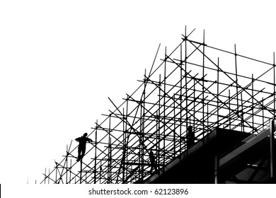 Silhouettes of builders on scaffolding