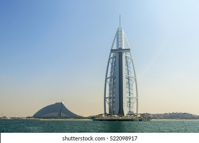 Silhouettes of buildings Burj Al Arab and Jumeirah hotels on Jumeirah beach in Dubai. Modern architecture, luxury beach resort, summer vacation and tourism concept. View from boat. Al Arab. Dubai.
