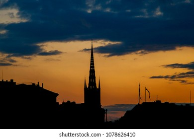 silhouettes of buildings on an orange sunset