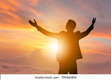 Silhouettes of Business Man Open Arms Under The Sunrise Sky Background, Celebration Success Happiness Concept.