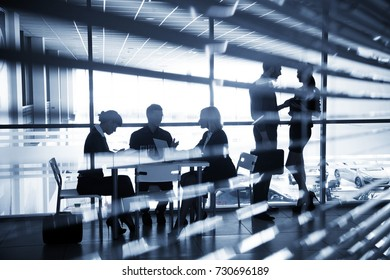 silhouettes of business people interacting  in office