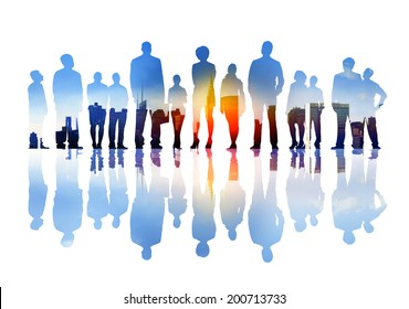 Silhouettes of Business People Looking Up in a City Scape